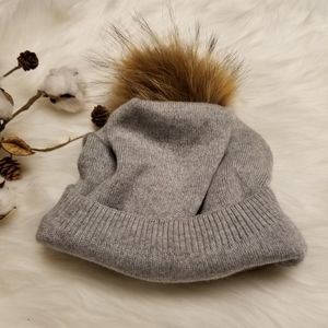 Super Soft hat with a fur ball on the top